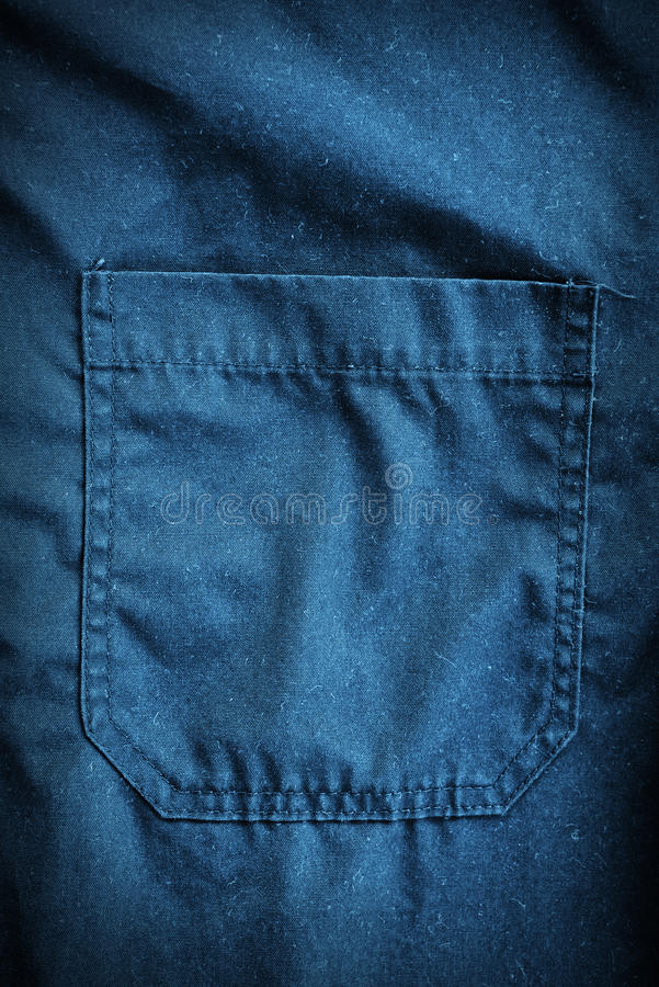 Coveralls detail. Blue coveralls detail. Working clothes detail stock photo