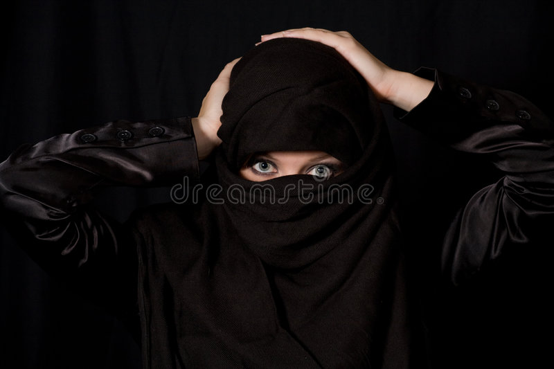 Covered. Traditional muslim headress with only eyes showing royalty free stock photo