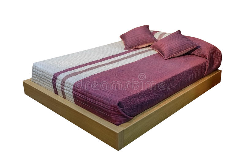Covered bed isolated on white background stock images