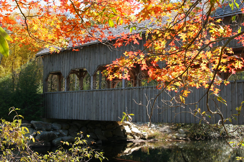 Covered bridge and autumn stock photos