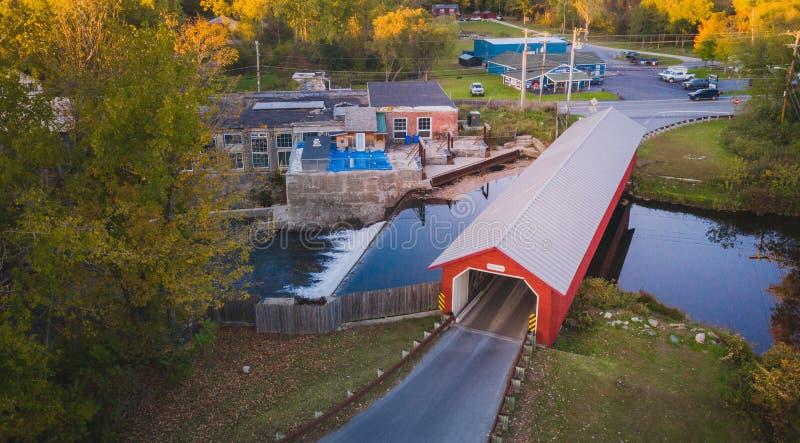 Covered Bridge over New England Stream stock photo