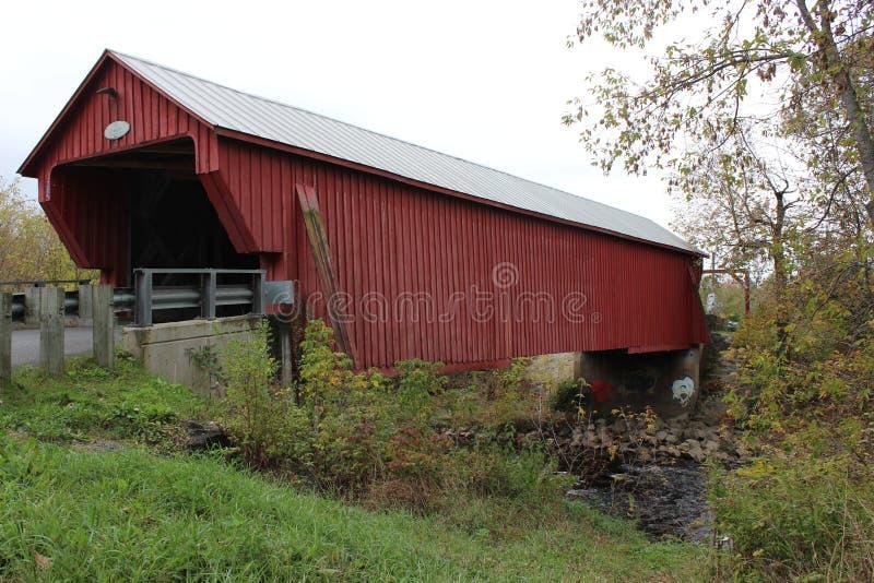 Covered Bridge. Freeport Covered Bridge in Cowansville over Yamaska River in Quebec stock images