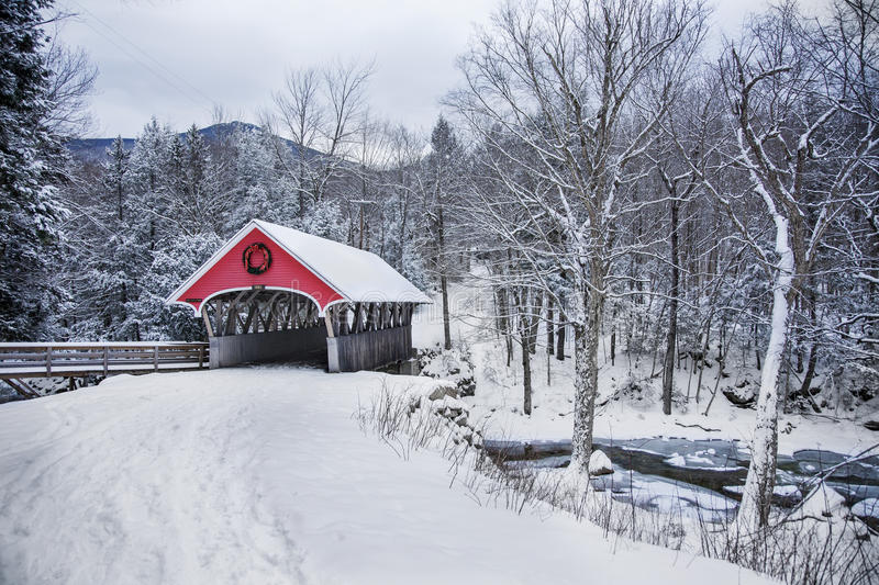 Covered bridge snowfall in rural New Hampshire stock photography