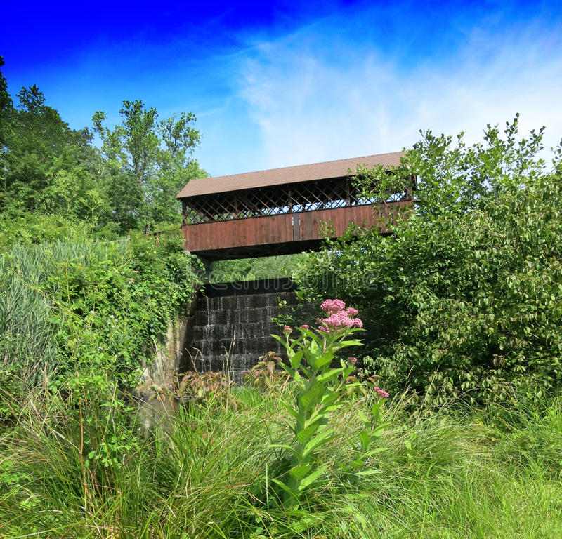 Covered bridge and waterfall stock photos