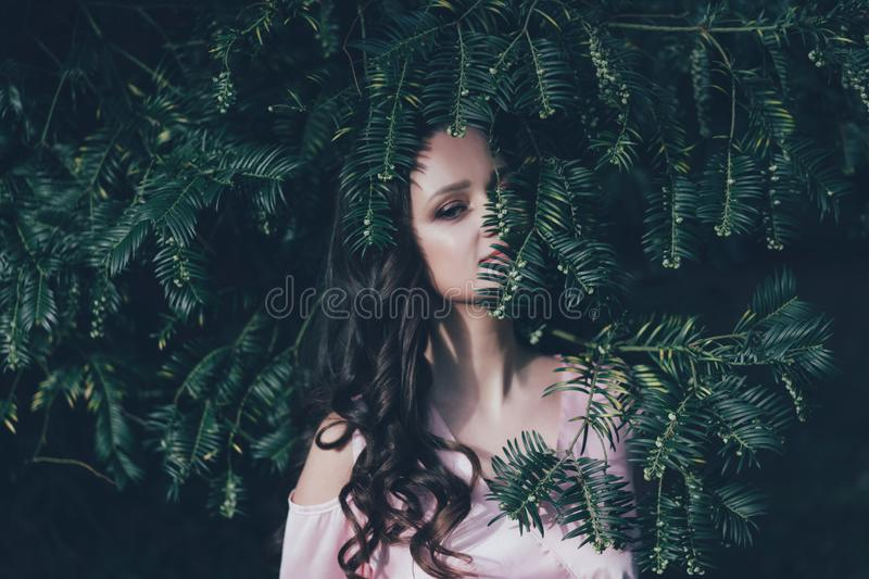 Covered face with a plant royalty free stock image
