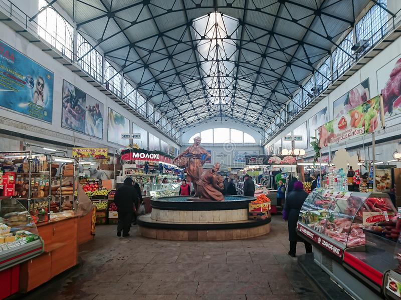 Covered market. Ancient building, built in 1916. Sale of various food products. People, buyers and sellers. Saratov / Russia - January 2, 2019: Covered market stock photos