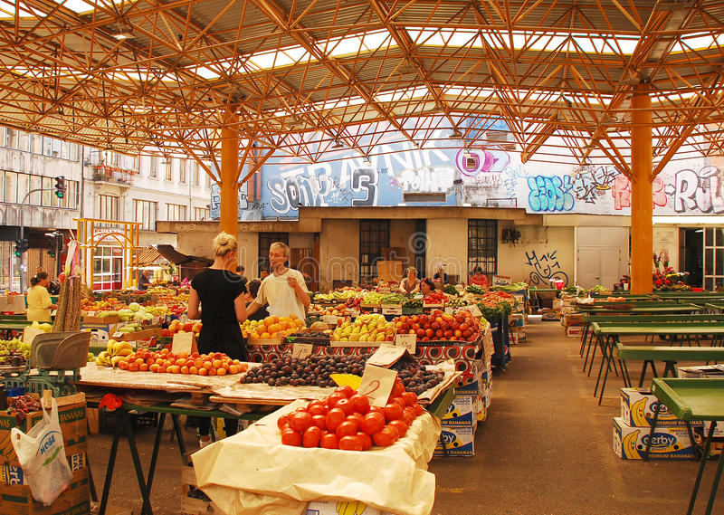 Covered Market in Sarajevo. Sarajevo, Bosnia and Herzegovina - August 10th 2014. A stall holder serves customers at the covered market in Mula Mustafe Baseskije stock photos