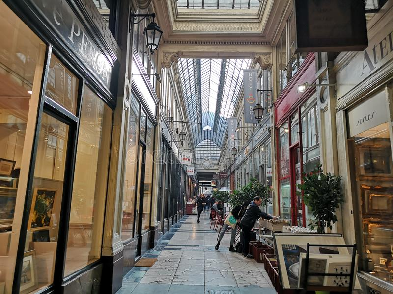 Covered passages of Paris, France. Passage Verdeau. The Covered Passage of Paris are an early form of shopping arcade built in Paris, France primarily during the stock photography