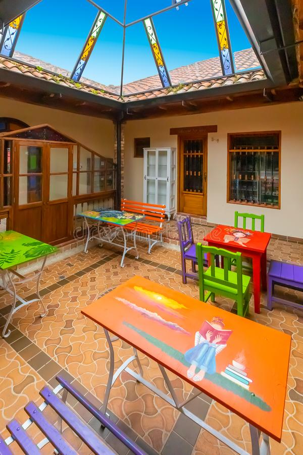 Covered patio with tables decorated in colonial house royalty free stock image