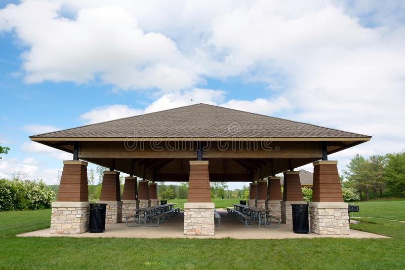 Covered picnic area and tables in public park. Covered picnic area and tables in public park on sunny day royalty free stock photos