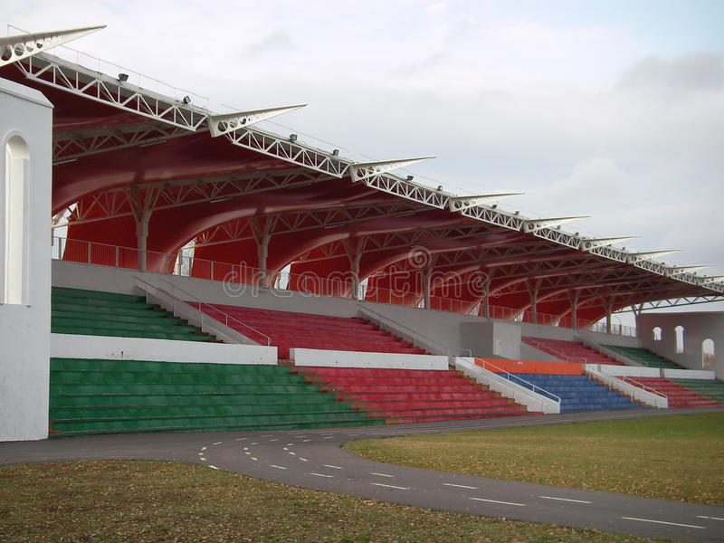 The covered sports tribune. The metal construction with an awning covering serves as shelter for the audience on tribunes from an atmospheric precipitation at royalty free stock photo