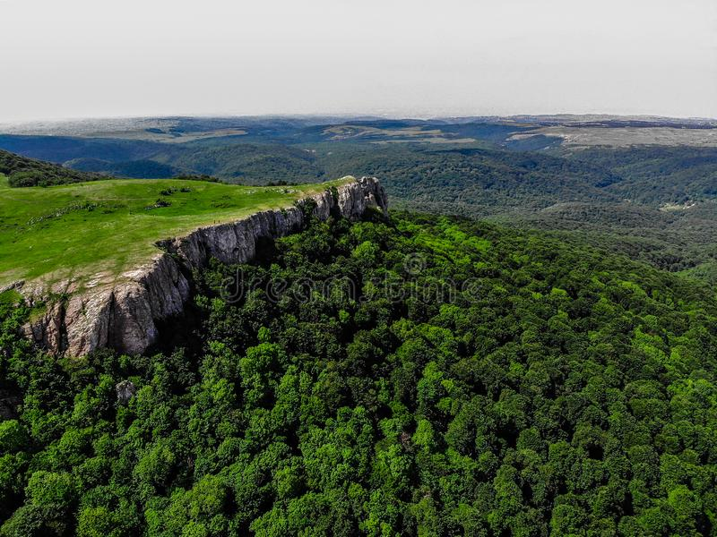 Covered with thick green forest mountains of Crimea stock photos