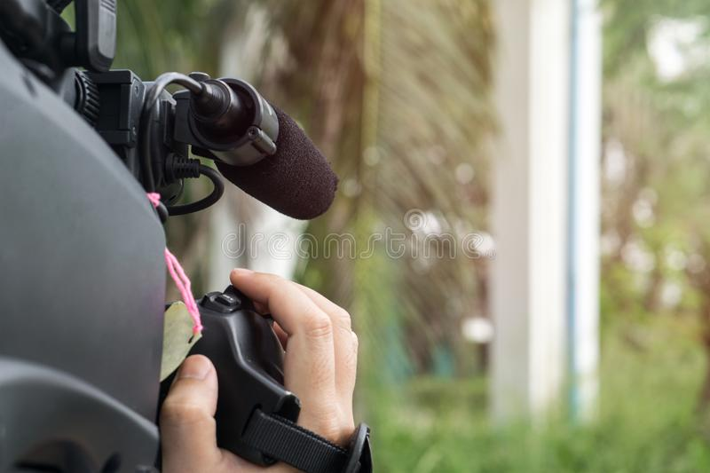 Covering an event with a video camera royalty free stock photo