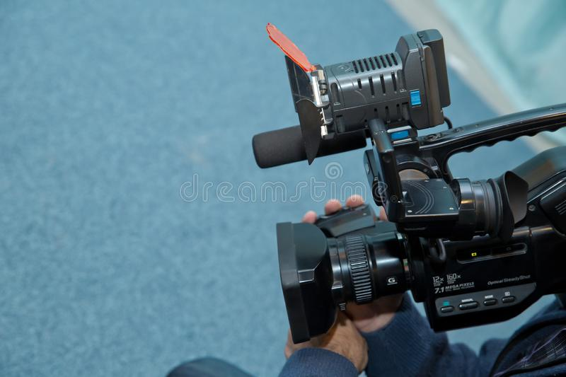 Covering an event with a video camera., Videographer takes video camera with free copy space for text., Video camera operator royalty free stock images