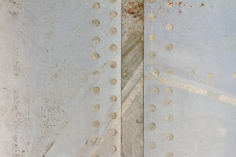 Covering the hull of the old aircraft on an abandoned airfield royalty free stock photography