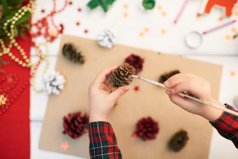 Covering Pinecone with Gouache stock photography