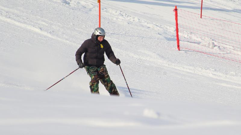 Covertly taken skiing man from a hill stock images