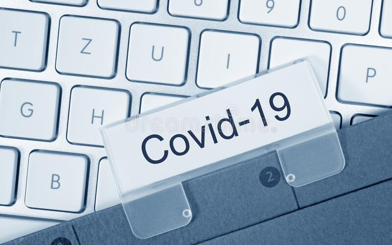 Covid-19 binder on computer keyboard in the office royalty free stock photos