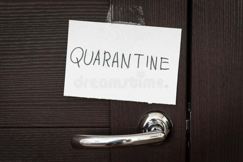 COVID-19 coronavirus concept, closed door with handle and note Quarantine. SARS-CoV-2 corona virus outbreak royalty free stock photo