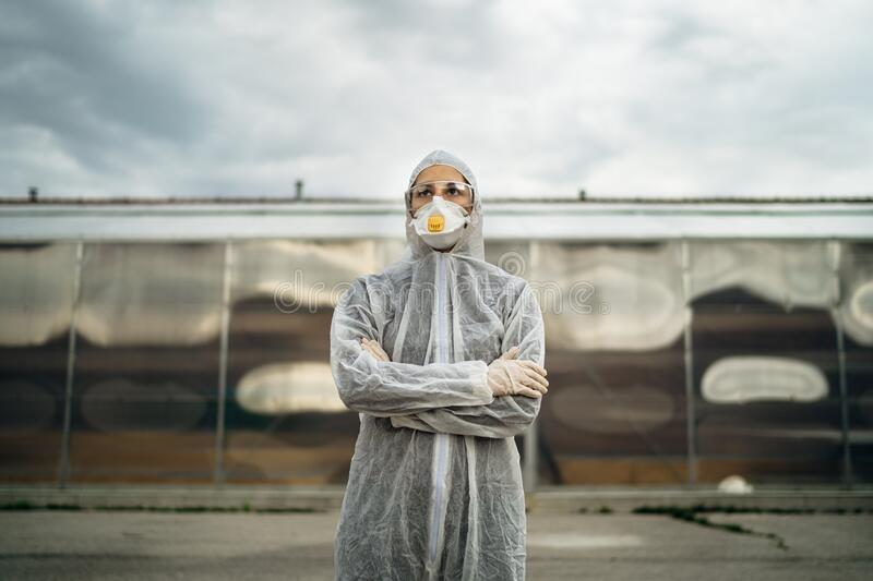 COVID-19 coronavirus doctor in hazmat suit.Infectious disease pandemic medical worker.Female physician in uniform on frontline,. Fighting viral outbreak stock photography