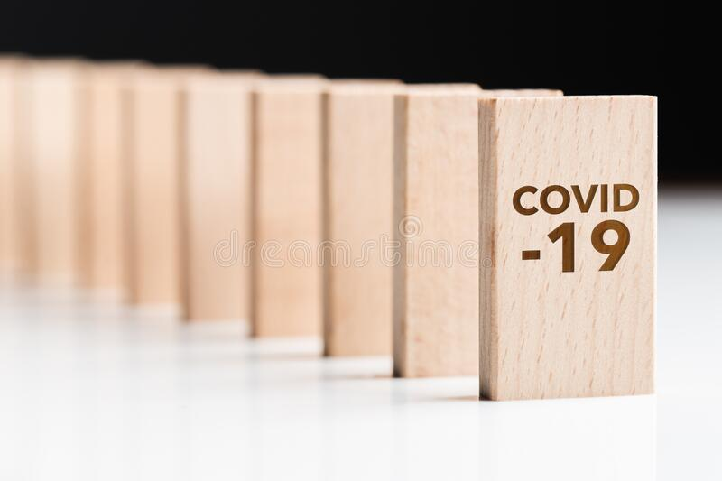 Covid-19 First Domino and Consequences royalty free stock image