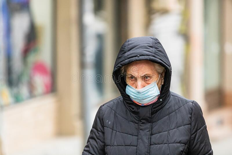 Covid-19 flu disease virus spreading in Europe. People wearing medical mask against coronavirus, influenza viruses and diseases. stock photo