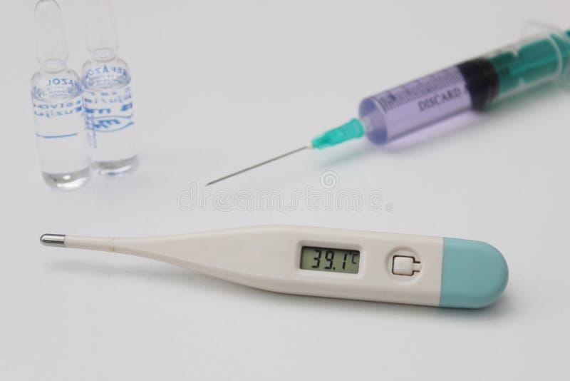 Covid-19 positive symptoms fever thermometer coronavirus stock images