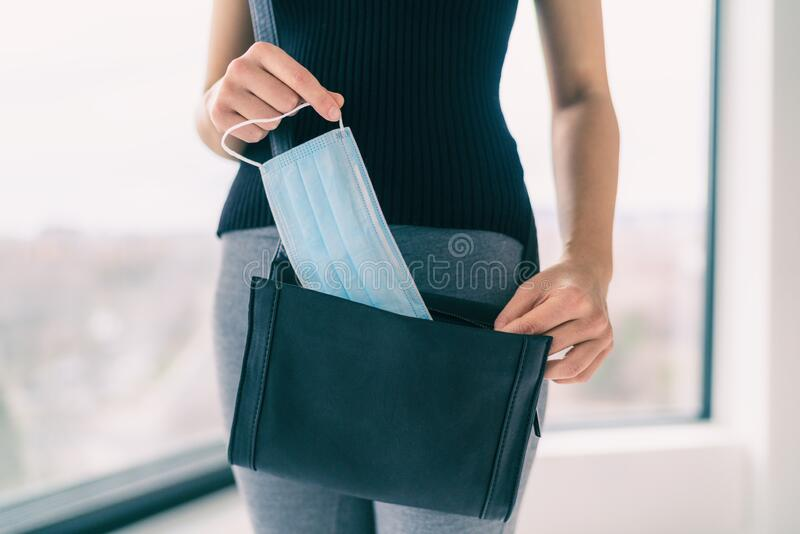 COVID-19 Prevention woman bringing medical mask in her purse for walking outside doing errands in public spaces and royalty free stock photos