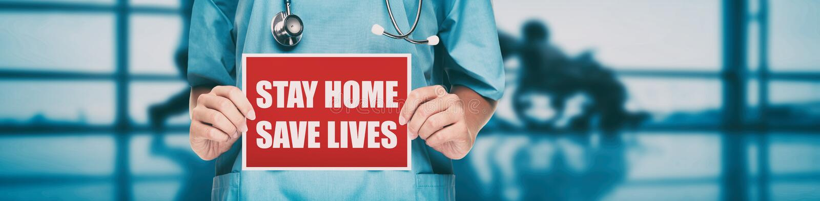 COVID-19 Social distancing quote medical nurse promoting staying at home to help workers. Coronavirus doctor holding. Sign in hospital background. Panoramic royalty free stock images