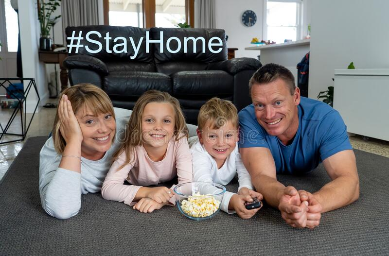 Covid-19 Stay at home, save lives. Family in staying home happy to stop the coronavirus spreading. COVID-19 pandemic - lockdown. Stay at home, save lives stock image