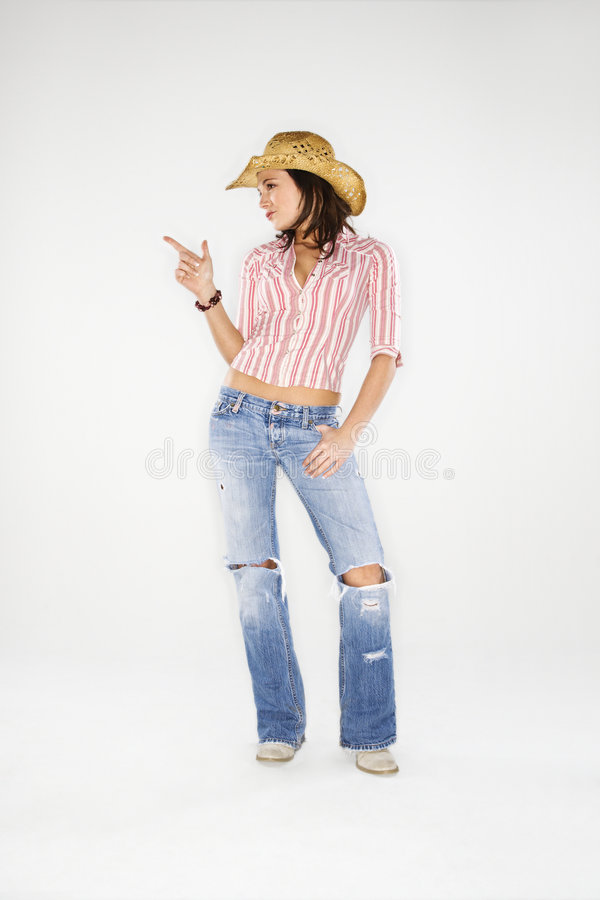 Cow-girl dirigeant le doigt image stock