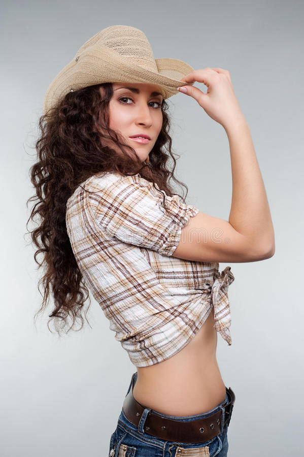 Cow-girl sexy dans le chapeau photo stock