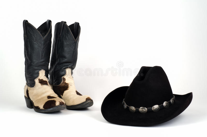 Cow Hide Cowboy Boots And Black Hat With Conchos Stock