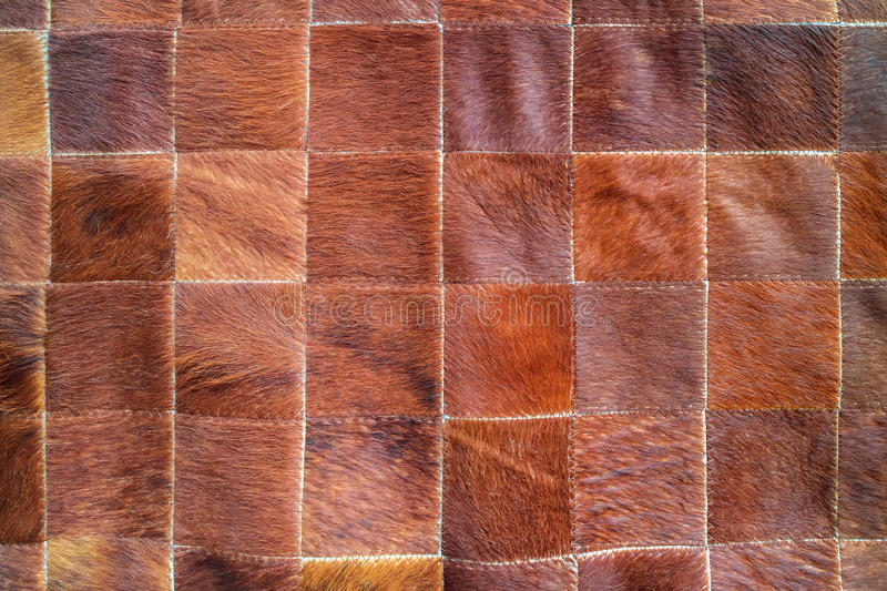 Cow leather with pattern. Cow leather with a square pattern royalty free stock photo