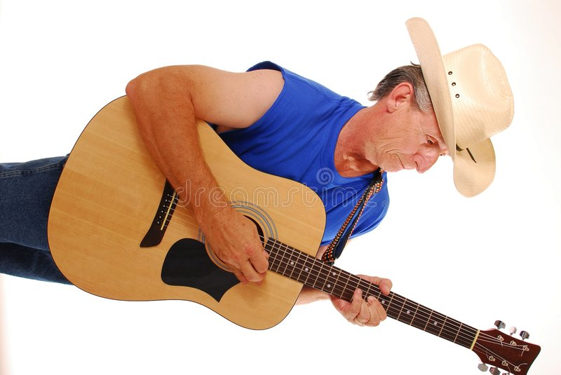 Cowboy with acoustic guitar royalty free stock photos