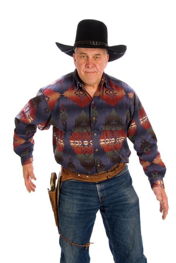 Cowboy atteignant pour son canon. photos libres de droits