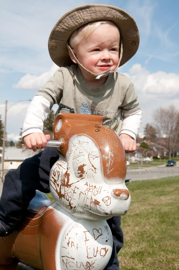 Cowboy auf einem Eichhörnchen stockbild