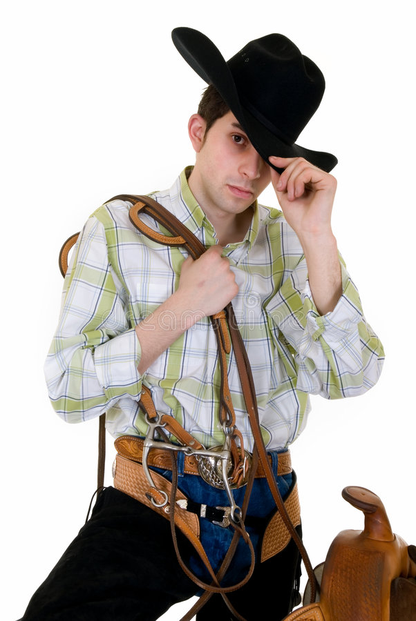 Cowboy avec la selle et la rêne photo stock