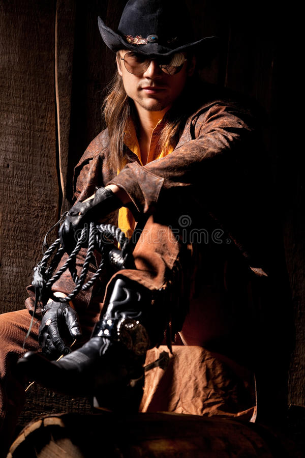 Download Cowboy With Black Leather Flogging Whip Stock Image - Image: 22838841