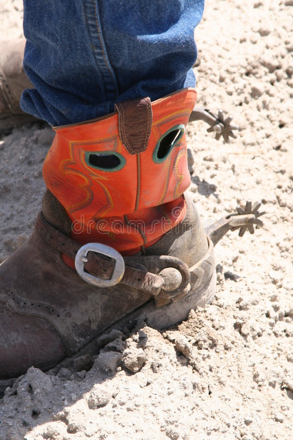 Cowboy- boot. Red cowboy boot with a spur and dirt royalty free stock photography