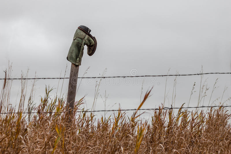Cowboy boot hanging on a fence post stock photos