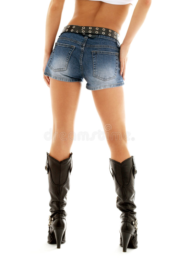 Cowboy boots and denim shorts stock photos