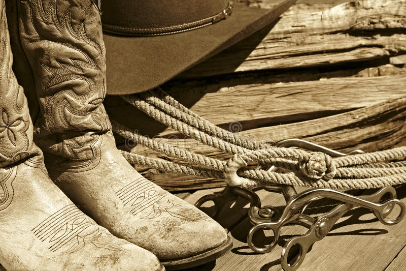 Cowboy Boots, Hat, Rope & Bits (Sepia) stock photo