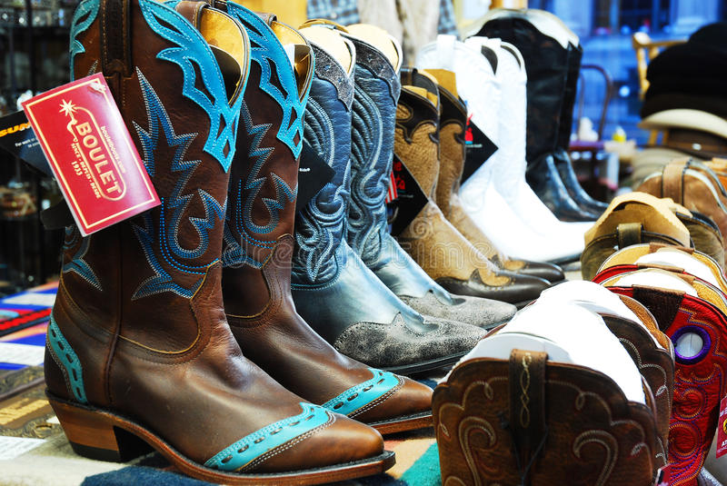 Cowboy Boots on Sale. Rows of cowboy boots lure customers to a western theme store stock photo
