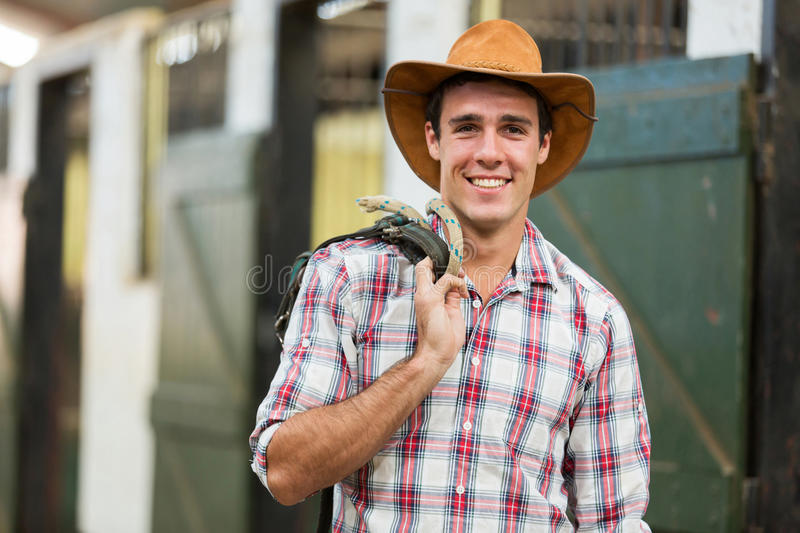 Cowboy carrying reins stock photo