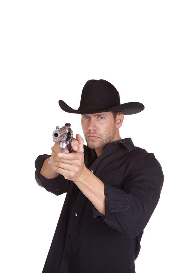 Cowboy che mira pistola fotografia stock
