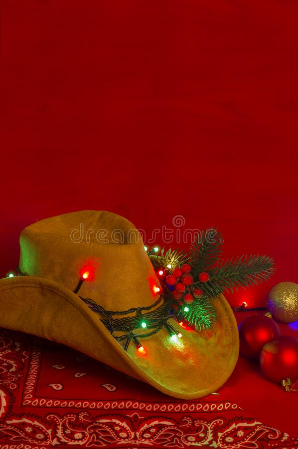 Cowboy Christmas.American West hat and bandanna on christmas red royalty free stock image