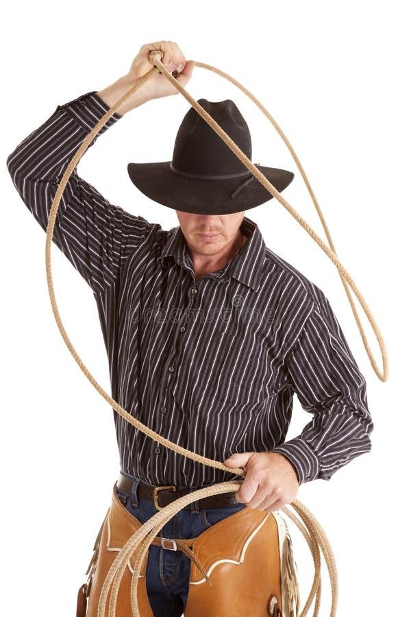 Cowboy com a corda aérea foto de stock