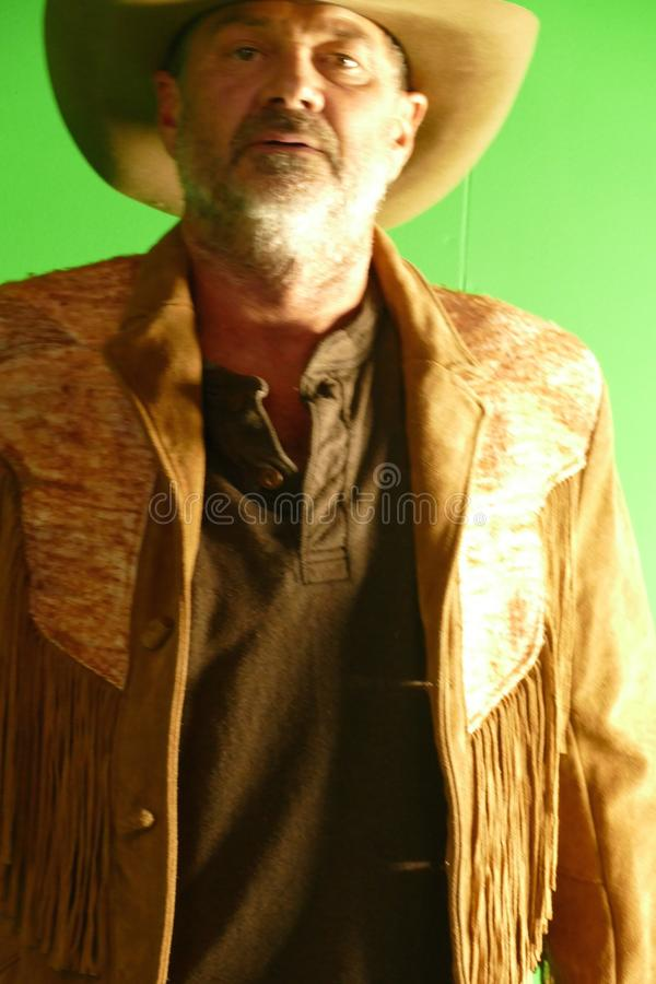 Cowboy con i puledri maschi di disegno del cappello fotografia stock libera da diritti