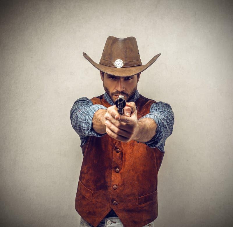 Cowboy con una pistola immagine stock libera da diritti
